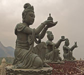 Statues In Front Of Buddha In Hong Kong — Stock Photo