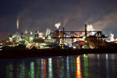 Fumes from steel mill in the harbour — Stock Photo