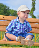 Baby boy in a park — Stock Photo