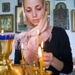 Girl with a candle. — Stock Photo #7032825