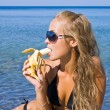 Girl with banana — Stock Photo #7032974
