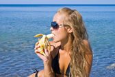 Girl with banana — Stock Photo