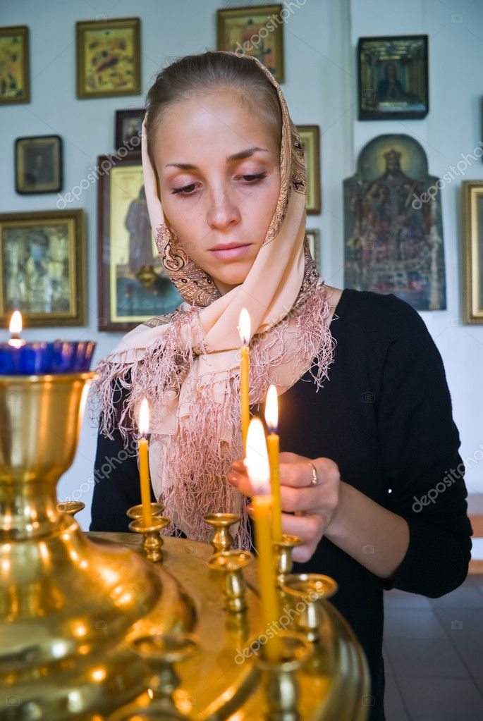 Girl with a candle in the Orthodox Church. — Stock Photo #7032825