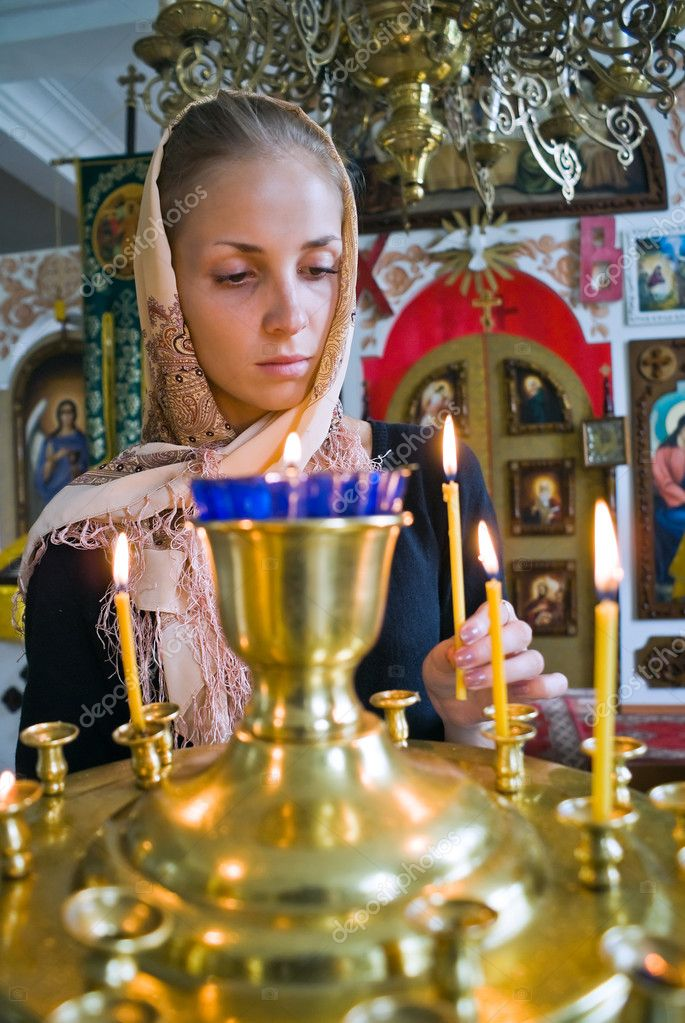 Girl with a candle in the Orthodox Church. — Stock Photo #7032917