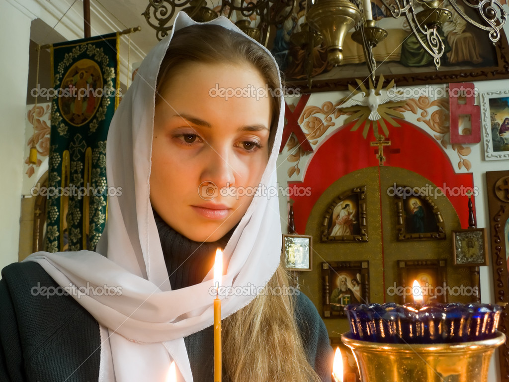 Girl with a candle in the Orthodox Church. — Stock Photo #7035605