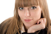 Portrait of smiling young woman resting her chin on hand — Stock Photo