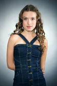 Portrait of a pretty young girl with long ringlets hair — Stock Photo