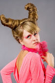Portrait of young woman wich pink plume — Stock Photo