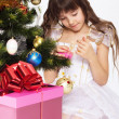 Little girl opening christmas present — Stock Photo #7516321