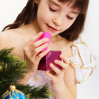 Little smiling girl opening christmas present — Stock Photo #7516363