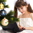 Little smiling girl looks at her laptop computer — Stock Photo #7516415