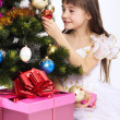 Little smiling girl holding Christmas-tree decoration — Stock Photo