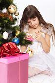 Little girl opening christmas present — Stock Photo