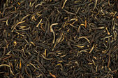 Black tea background — Stock Photo