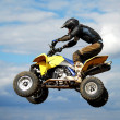Quad jumping — Stock Photo