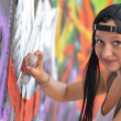Girl against a wall with graffiti — Stock Photo #7084560