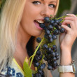 Stock Photo: Beautiful young woman with grape