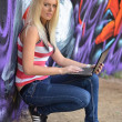 Girl against a wall with graffiti — Stock Photo #7084578