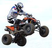 Quad rider jumping — Stock Photo