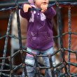 Small girl playing on children's playground — Stock Photo