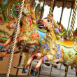 Pony rides on a merry-go-round carousel. - Stock Photo