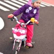 Little girl riding on her pink bike — Stock Photo #7150276