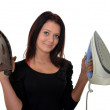 Woman with old and new iron — Stock Photo