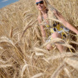 Happy woman in golden wheat field — ストック写真 #7193537