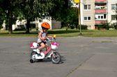 Baby girl on bike — Stock Photo