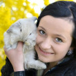 Beautiful girl with rabbit — Stock Photo