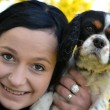 Girl with dog in spring — Stock Photo #7221830