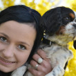 Girl with dog in spring — Stock Photo #7221832