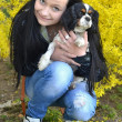Girl with dog in spring — Stock Photo #7221840