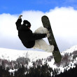 Flying snowboarder on mountains — Foto Stock