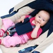 Baby in car seat over white — Stock Photo #7227964