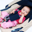 Baby in car seat over white — Stock Photo