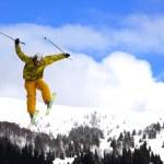 Flying freeskier on mountains — Stock Photo