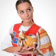 Woman with ceramic cow — Stock Photo