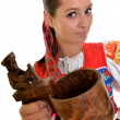 Traditional slovakian woman with dippers — Stock Photo