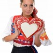 Beautiful girl shows a gingerbread heart — Stock Photo #7280373