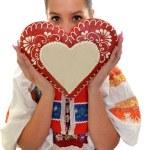 Beautiful girl shows a gingerbread heart — Stock Photo #7295745