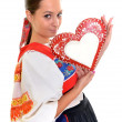 Beautiful girl shows a gingerbread heart — Stock Photo #7295750