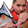 Pretty woman with old sewing machine — Stockfoto