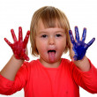 Little girl with paint over white background - Foto Stock