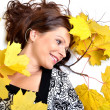 Stock Photo: Young woman with autumn leaves