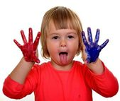 Little girl with paint over white background — Stock Photo