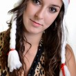 Beautiful christmas woman in santa hat holding empty board — Stock Photo #7372252