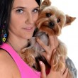 Young woman and sweet puppy playing around - 