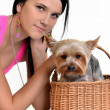 Woman with puppy on basket — Stock Photo