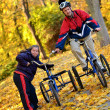 Down syndrome couple on bikes — Stock Photo #7459080